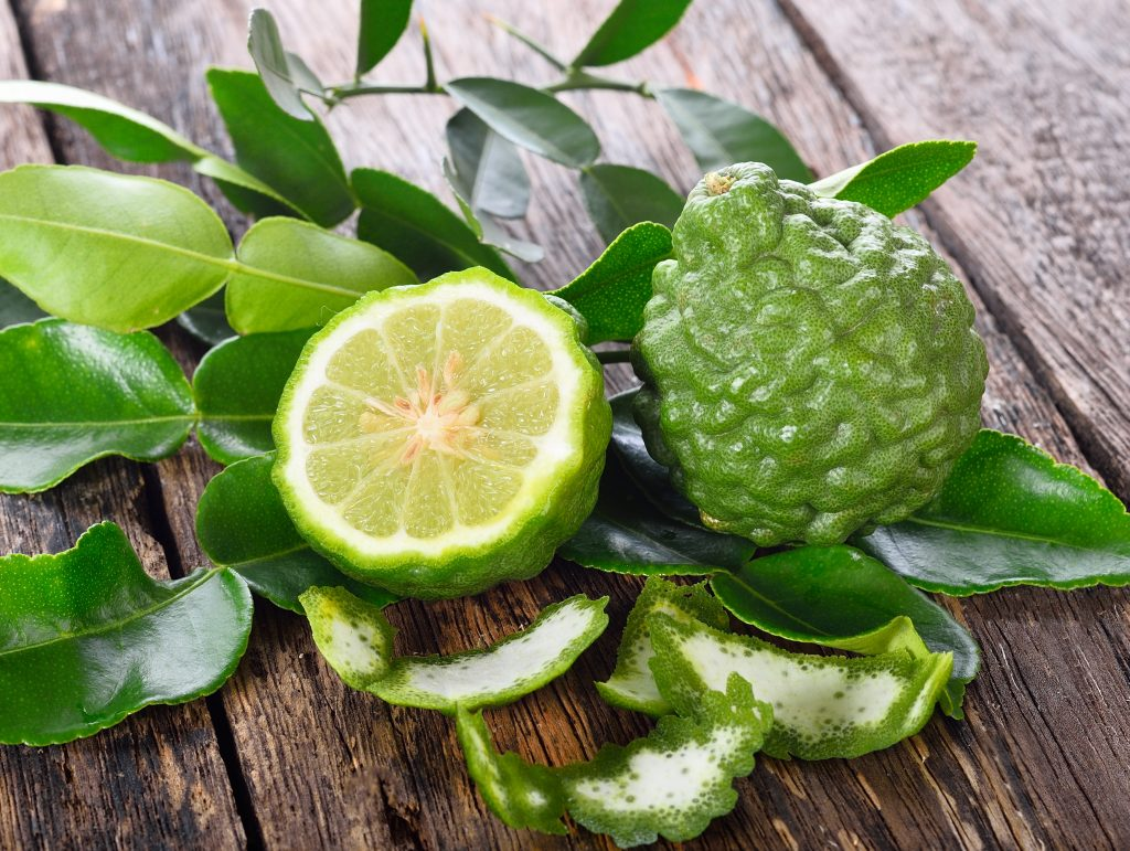 Fresh bergamot on wooden background